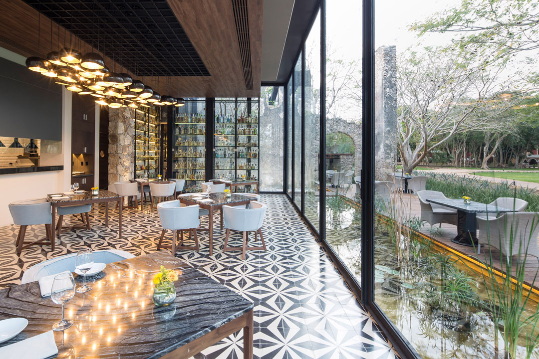 The Materials Used Such As Wooden Ceiling Panels And Tiled Floors Add Additional Contrast To Old Ruin Walls Modern Glass