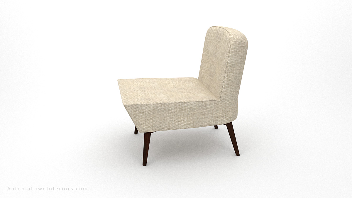 Side view Timeless Low Wedge Chair neutral linen cream colour fabric low level chair with wooden legs.