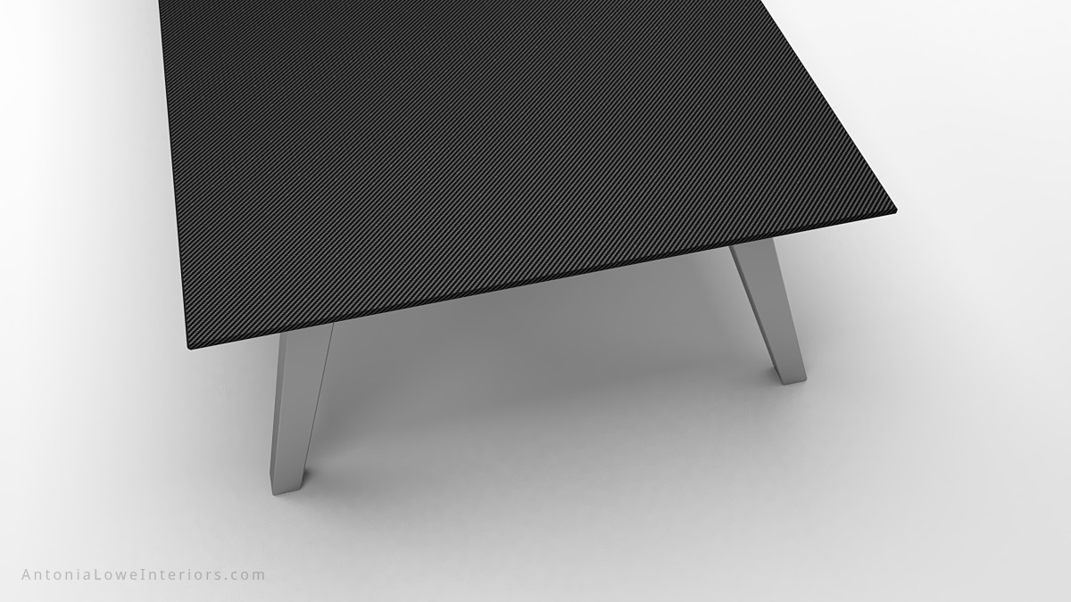 Close up top view Dark Masculine Carbon Fibre Board Room Table thin carbon fibre table top on thick brushed stainless steel legs