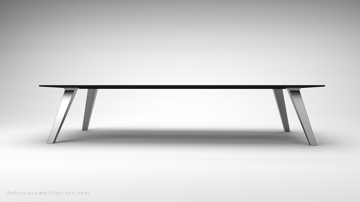 Front view Dark Masculine Carbon Fibre Board Room Table thin carbon fibre table top on thick brushed stainless steel legs