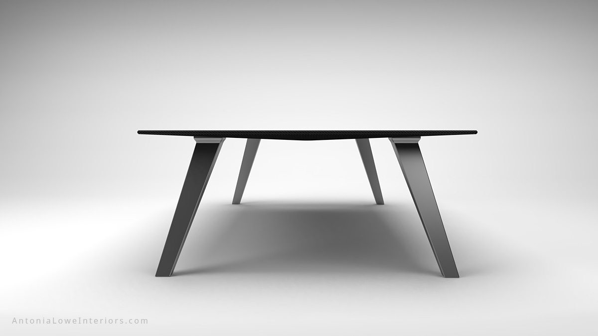 End view Dark Masculine Carbon Fibre Board Room Table thin carbon fibre table top on thick brushed stainless steel legs
