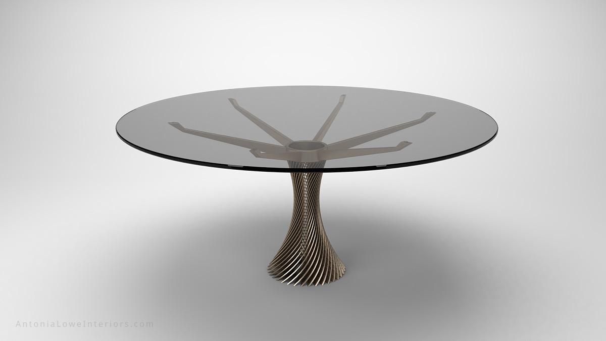 Stunning Twist Column Round Table clear glass round table top held by a single central twisted stripe metal support that branches out at the top to hold the glass table top