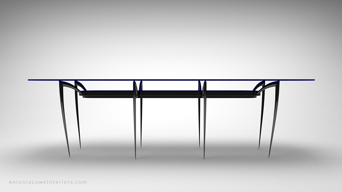 Front view Modern Elegant Black Widow Dining Table long large eight spider leg black table legs with a large pill shape piece of sapphire blue glass as the table top
