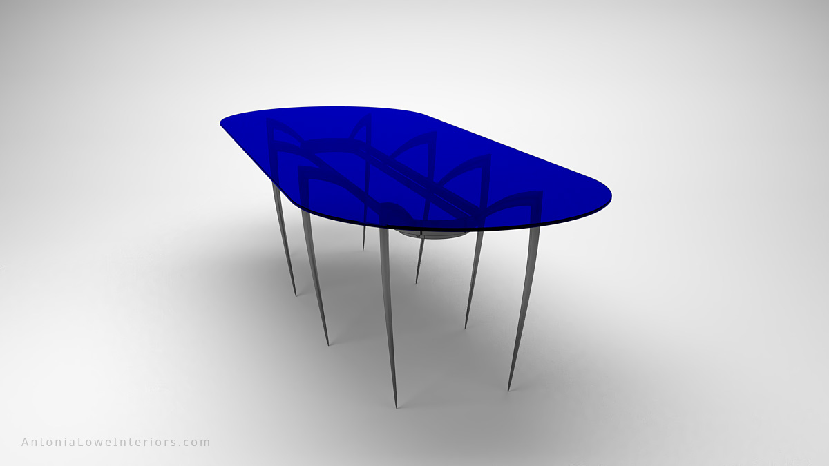 Modern Elegant Black Widow Dining Table long large eight spider leg black table legs with a large pill shape piece of sapphire blue glass as the table top