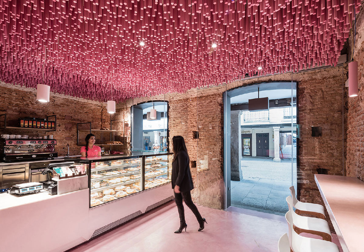 Superior Historic Brick Bakery Interior With Modern Installation Of 12,000 Magenta  Pink Wooden Rods Hanging From The