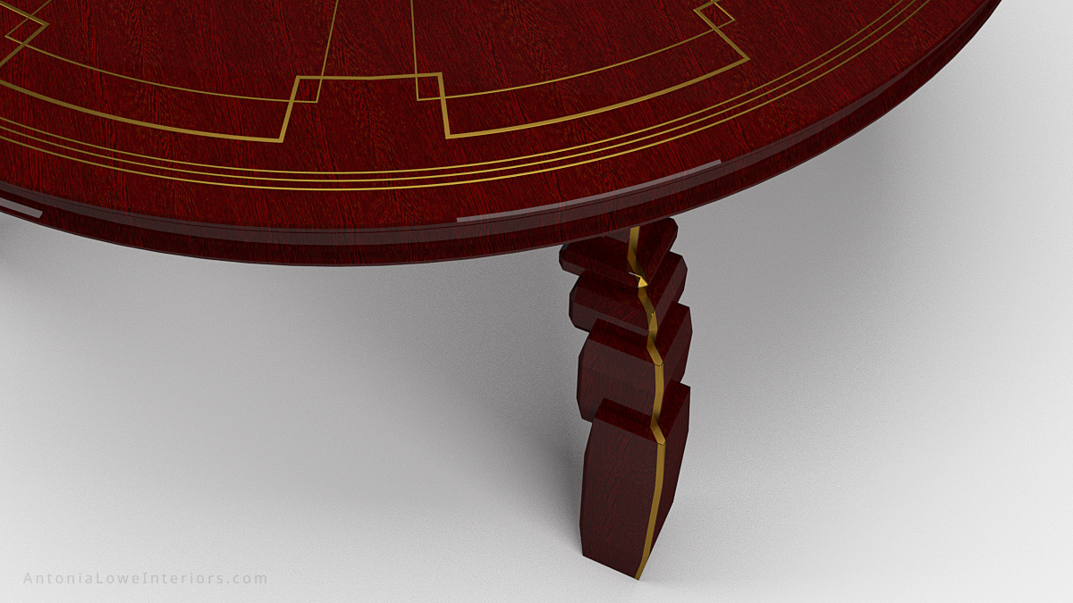 Close up Art Deco Inspired Red Round Table made from beautifully varnished red wood with gold art deco inspired detailing on the table top and on the legs. Leg detail.