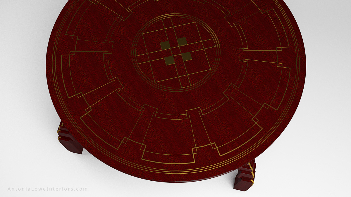 Close up top view Art Deco Inspired Red Round Table made from beautifully varnished red wood with gold art deco inspired detailing on the table top and on the legs.