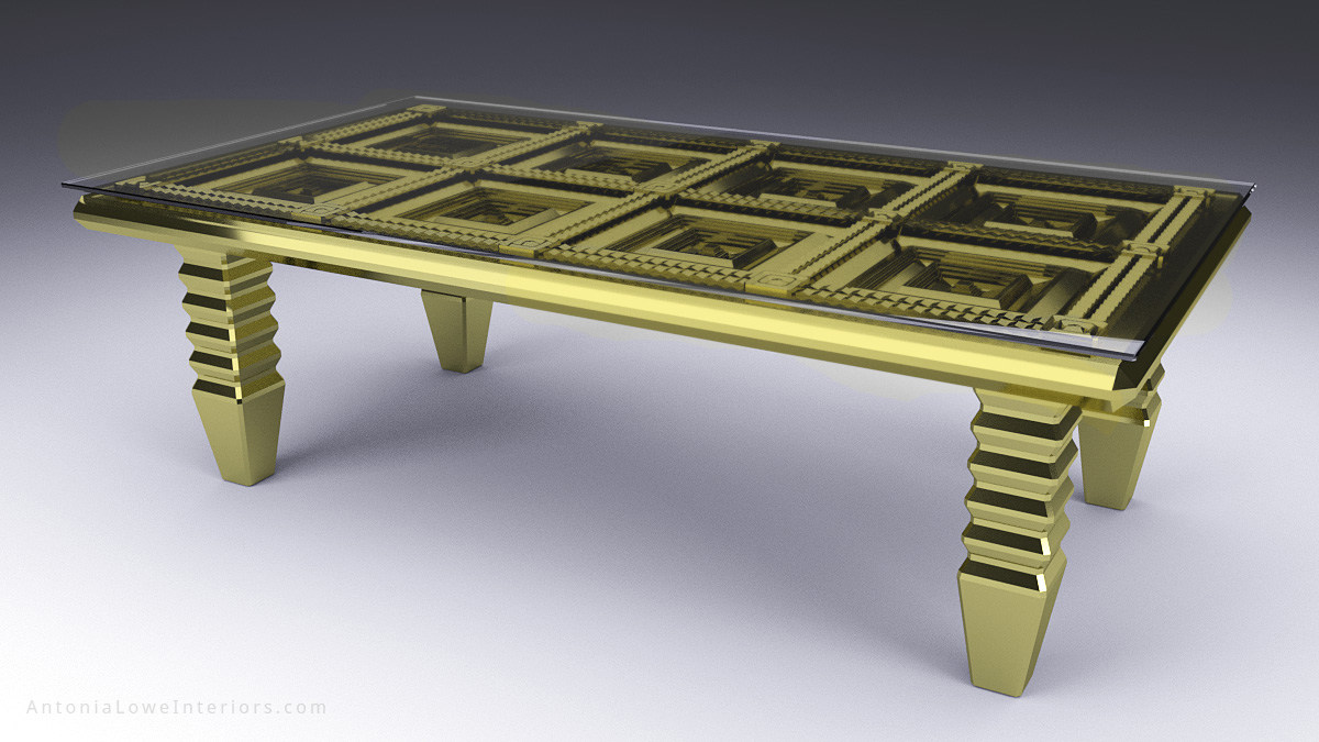 Bespoke gold table with faceted detailed table top underneath a glass top.