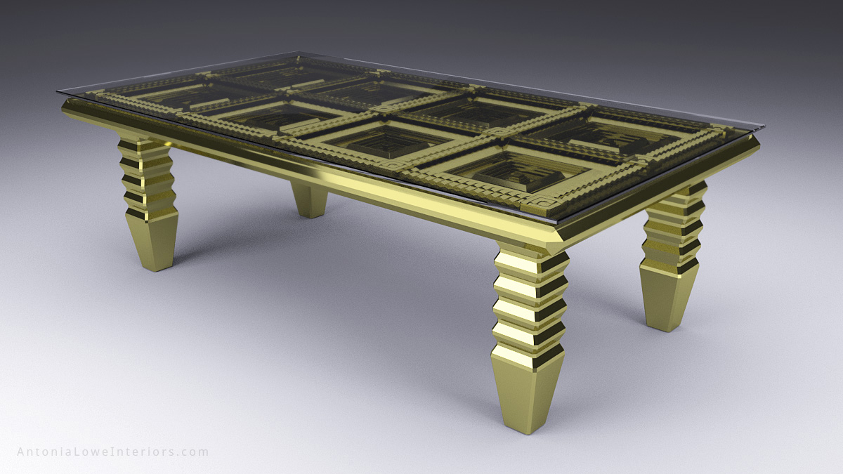 Bespoke gold table heavily gilded with faceted detailed table top underneath a glass top.