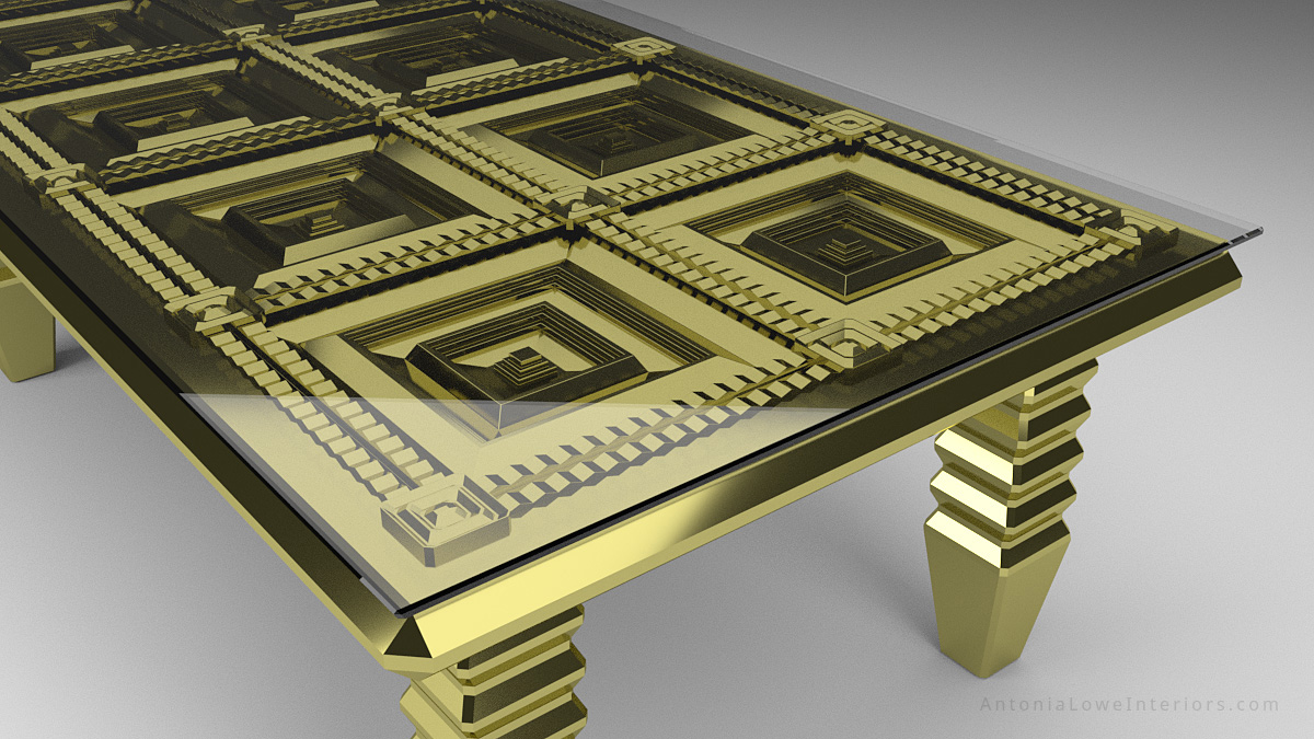 Close up view of heavily gilded Bespoke gold table with faceted detailed table top underneath a glass top.