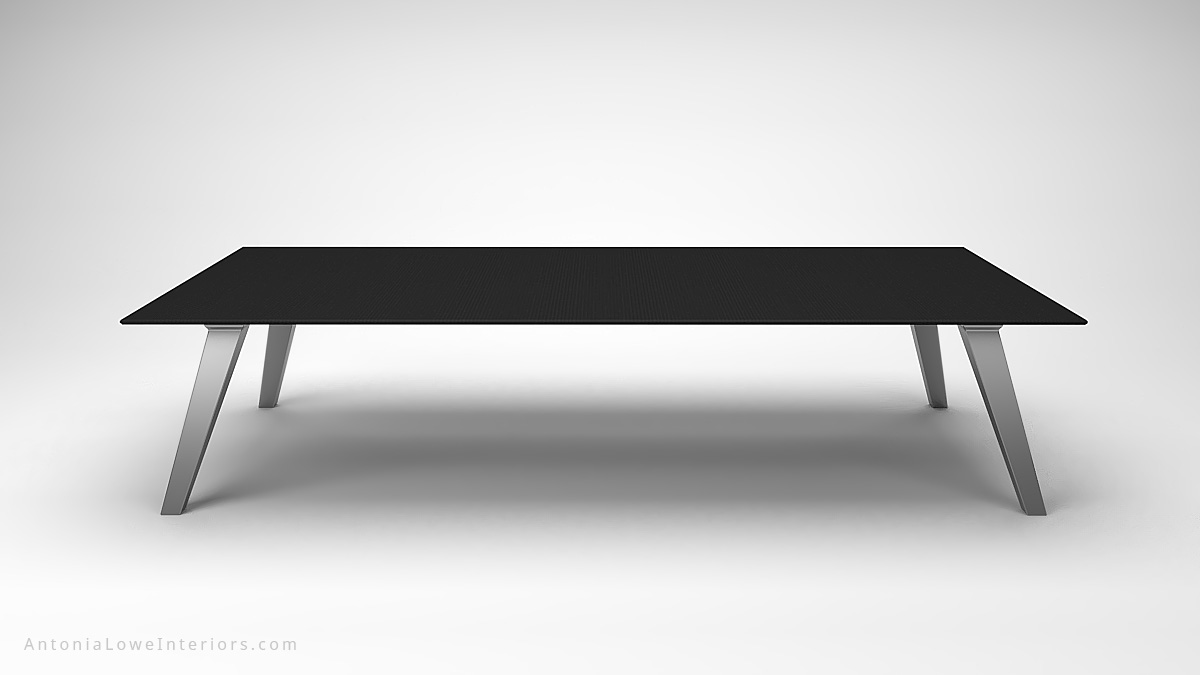 Front View close up Dark Masculine Carbon Fibre Board Room Table thin carbon fibre table top on thick brushed stainless steel legs