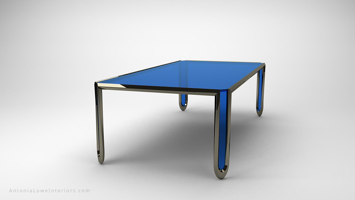 Modern Glass Drop Leg Table blue clear glass table top and legs which are all framed with a shiny polished chrome frame