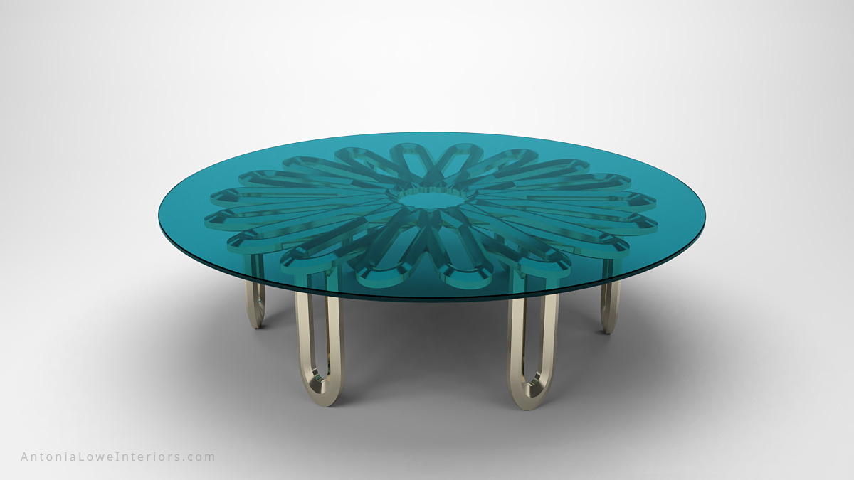 Elegant Contemporary Floral Coffee Table clear teal glass round table top with metal floral detailing underneath supported by metal legs all in polished chrome