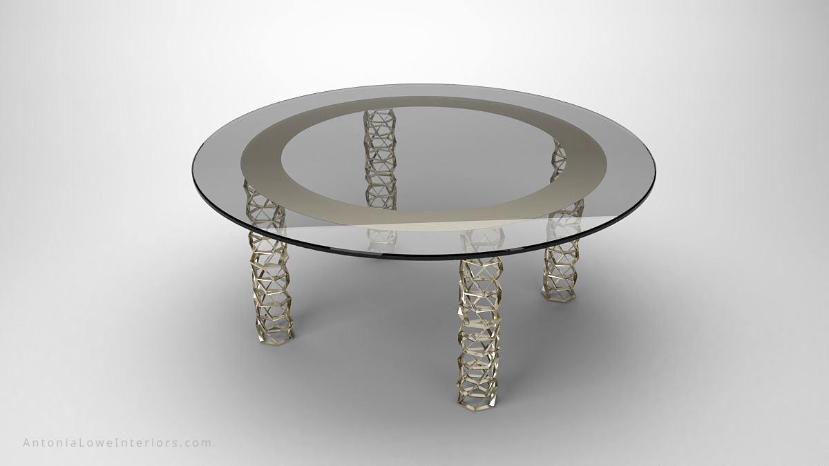 Sophisticated Contemporary Matrix Grid Table round clear glass table top with pale frosted ring above where legs join and the legs are shiny gold cylindrical matrix grids with holes
