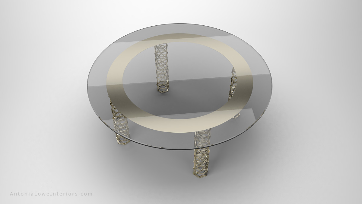 Top View Sophisticated Contemporary Matrix Grid Table round clear glass table top with pale frosted ring above where legs join and the legs are shiny gold cylindrical matrix grids with holes
