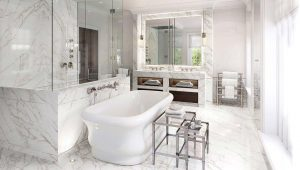 Surrey Family Home Luxury Bathroom with white marble, large mirrors and a large roll top bath with polished chrome fixtures