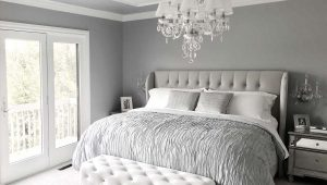 Luxurious Oxford apartment master bedroom with beautiful light white and pale grey tones, accented with silver details.