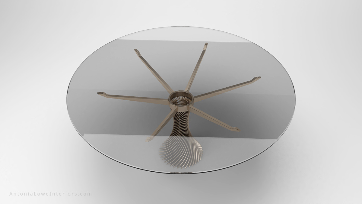 Top View Stunning Twist Column Round Table clear glass round table top held by a single central twisted stripe metal support that branches out at the top to hold the glass table top