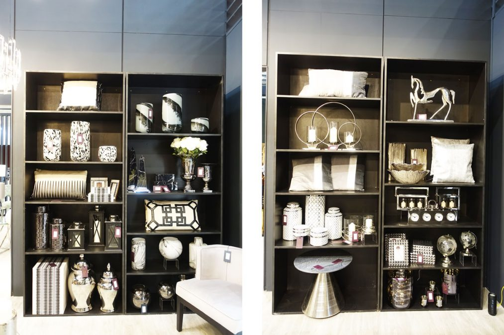 Monochrome Interior Design Home Accessories on shelves with cushions, vases, jars, lanterns and picture frames